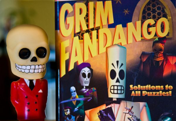 Grim Fandango poster next to a promotional bobblehead. One of the many games Tim Schaefer is known for.